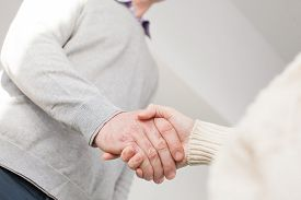 image of youg  - Handshake of adult man and youg woman - JPG