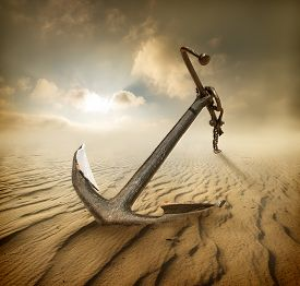 stock photo of anchor  - Anchor in the desert and cloudy sky - JPG