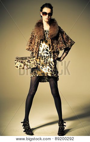 Full body fashion model in fashion clothes posing on light background