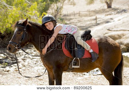 Sweet Young Girl Hugging Pony Horse Smiling Happy Wearing Safety Jockey Helmet In Summer Holiday