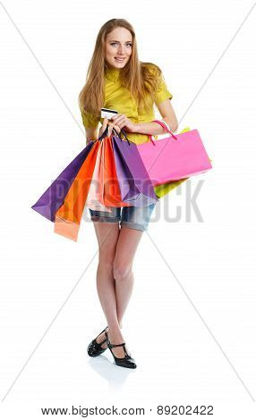 Shopaholic Woman With Shopping Bags And Credit Card Over White Background