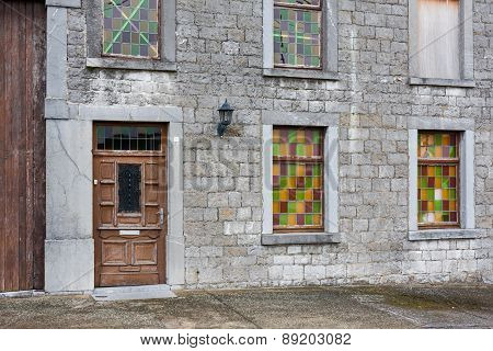Ancient House With Brick Wall And Colorful Windows