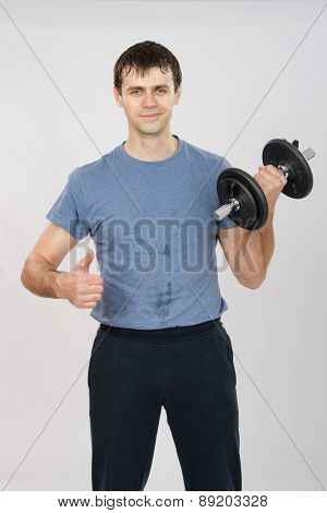 Athlete With A Dumbbell Shows Class
