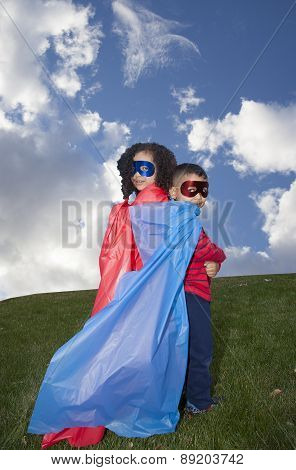 Little Boy And Girl Superhero Against Blue Sky