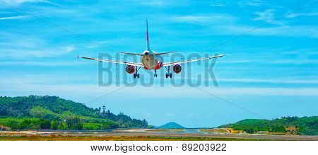Commercial Airliner Landing At An Airport In Southeast Asia