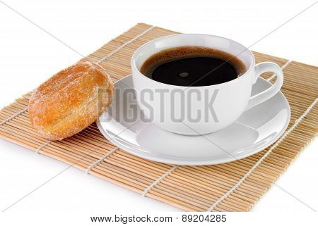 Cup Of Black Coffee And A Doughnut On White Background