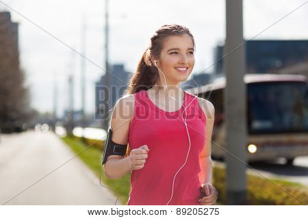 Young beautiful woman running in the city.
