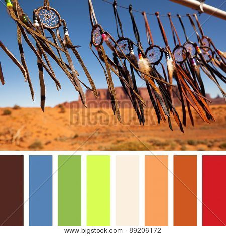 Hand crafted Native American dreamcatchers fluttering in a breeze, in Monument Valley, Utah, USA. In a colour palette with complimentary colour swatches.