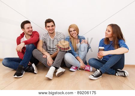 Group of four young people indoors