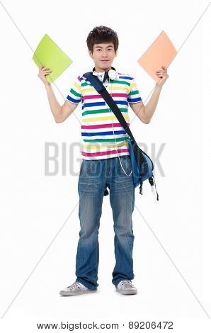 Full body casual young student with backpack holding notebook