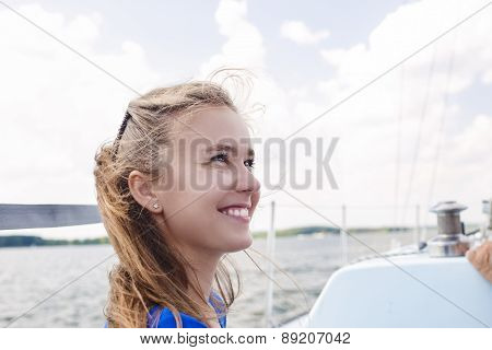 Portrait Of Happy Caucasian Woman Sailing On Yacht
