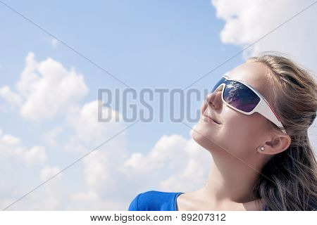 Profile Of Young Smiling Caucasian Blond Female Wearing Sunglasses