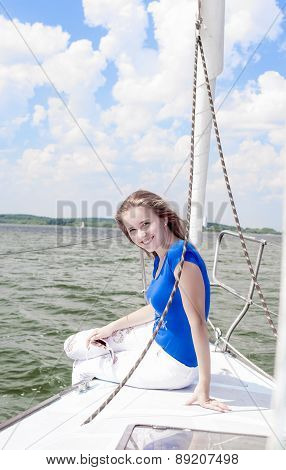Sexy Cute Smiling Positive Caucasian Woman Relaxing On White Yacht On Board
