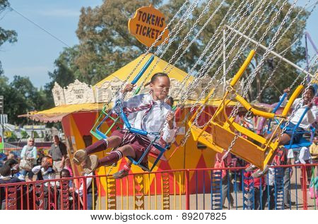 Visitor Enjoying The Amusement Park At The Annual Bloem Show