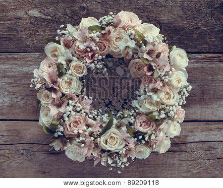 Roses Wreath On Wooden Background. Retro Stylized.