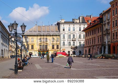 Krakow, Poland - March 07 2015: Unidentified Tourists Visiting Small Market Square In Krakow, Poland