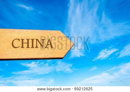 Wooden arrow sign pointing destination CHINA