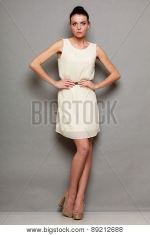 Glamour Girl In White Dress On Gray