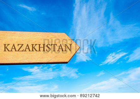 Wooden arrow sign pointing destination KAZAKHSTAN