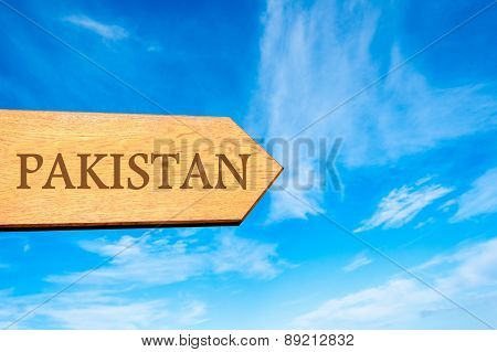 Wooden arrow sign pointing destination PAKISTAN