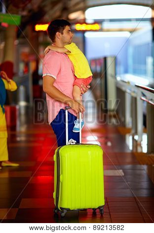 Man Travelling With Kid On Hands