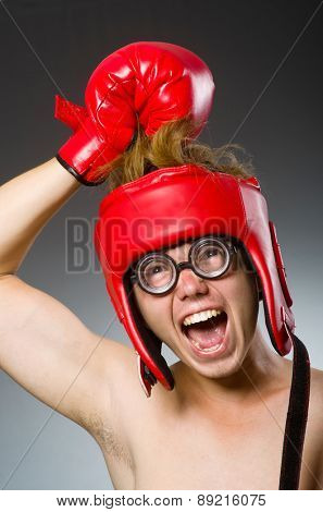 Funny boxer against dark background