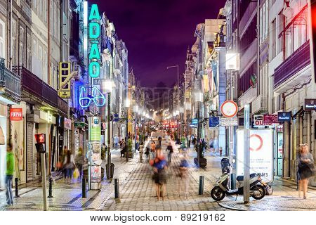 PORTO, PORTUGAL - OCTOBER 16, 2014: Shoppers stroll on Rua Santa Catarina pedestrian street.