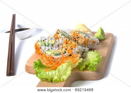 Set Of California Sushi Rolls On A Wooden Board With Chopsticks And Soy Sauce On White Background