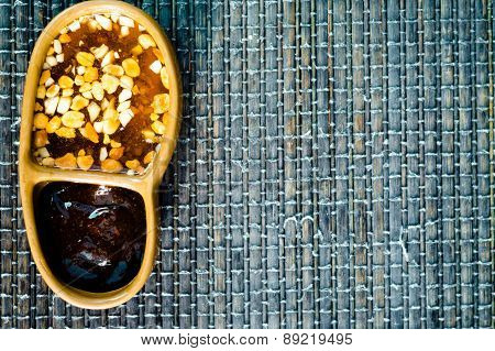 Garlic Oil In Small Bowl On Bamboo Background
