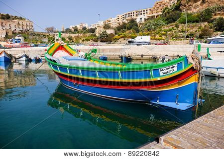 MGARR, GOZO ISLAND, MALTESE ISLANDS - APRIL 17, 2015:Marsaxlokk, a traditional maltese village  fishing boat, Mgarr Gozo, Malta