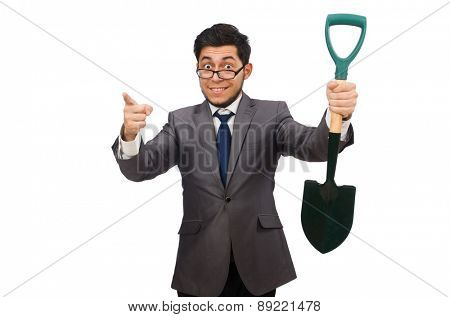 Young businessman holding a spade isolated on white