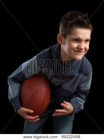 Young Boy Posing With Football