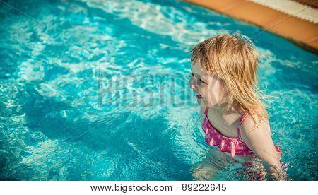 little cute girl near the pool