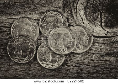Vintage Indian Head Nickels On Wood