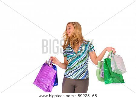 Studio shot of young blonde woman with shopping bags