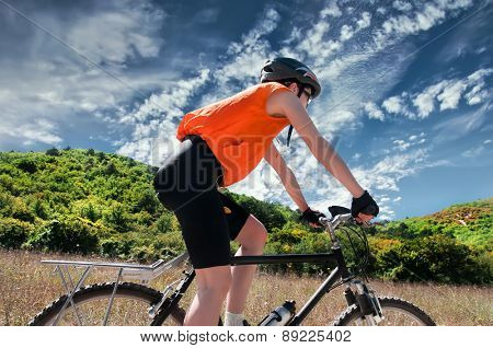 Mountain Biker with  background of blue sky