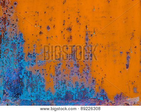 Rusty Painted Metal With Cracked Paint. Orange And Blue Colors. Texture Color Grunge Background