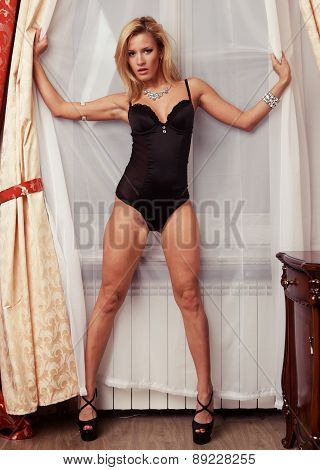 Young sexy lingerie woman posing