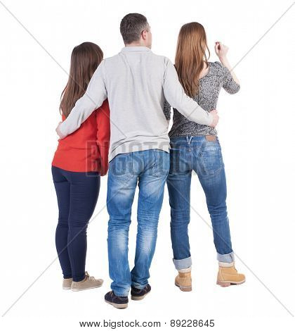 Back view of three friends  (woman and man). A guy in a gray jacket hugging two friends.  backside view of person.  Isolated over white background.