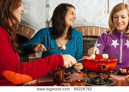 Three Women Having Fondue Dinner