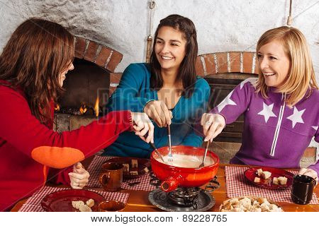 Friends Having Fondue Dinner