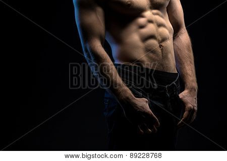 Portrait of handsome athlete topless at the studio