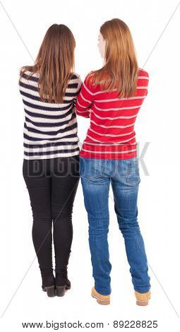 Back view of two young girl (brunette and blonde)  . Rear view people collection.  backside view of person. beautiful woman friends  showing gesture. Rear view. Isolated over white background.