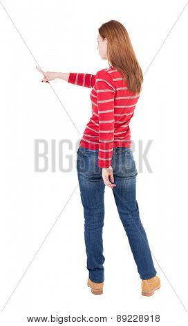 Back view of  pointing woman. beautiful girl. Rear view people collection.  backside view of person.  Isolated over white background.