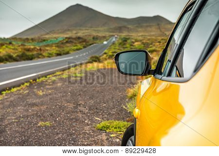 Yellow car on a background of mountains