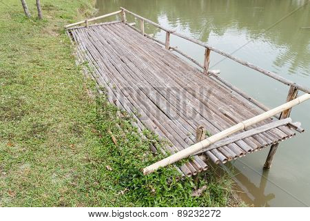 Wooden Pier Beside The Lake