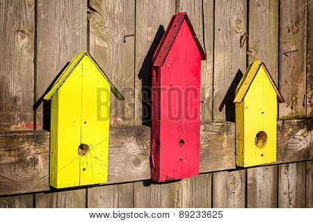 Decorative imitation birdhouses used as garden ornaments.