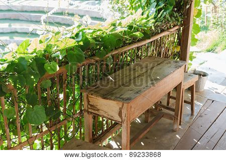 Wooden Table And Chair Beside The Garden