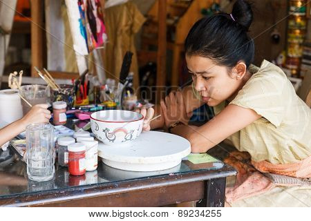 The Girl Is Painting The Bowl