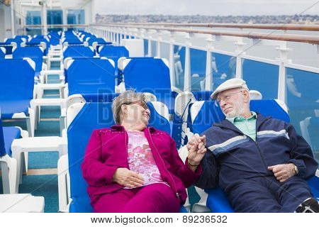 Happy Senior Couple Relaxing On The Deck of a Luxury Passenger Cruise Ship.